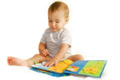 Baby boy reading a book. Over white Royalty Free Stock Image
