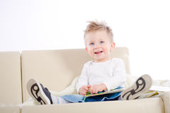 Baby boy reading book Royalty Free Stock Photography