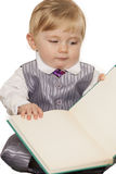 Baby boy reading a book. Isolate on white background Royalty Free Stock Images