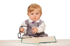 Baby boy reading a book. Nerdy bay boy reading a book Royalty Free Stock Images
