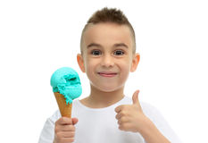 Baby boy ready for eating blue icecream in waffles cone showing. Thumb up isolated on a white background Royalty Free Stock Images