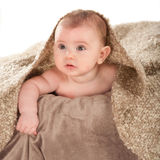 Baby on the blanket. Baby boy reclining on brown blanket Royalty Free Stock Images
