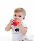 Baby boy with red apple Stock Photo
