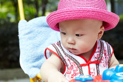 Baby boy in red hat Stock Image