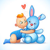 Baby boy redhead hugs bunny toy on a white Stock Images