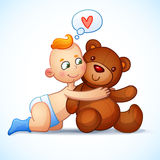 Baby boy redhead hugs Teddy Bear toy on a white Stock Photo