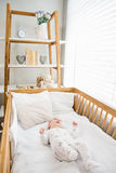 Baby boy relaxing on a cradle Royalty Free Stock Photos
