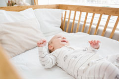 Baby boy relaxing on a cradle. At home Royalty Free Stock Photography