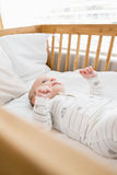Baby boy relaxing on a cradle Royalty Free Stock Images