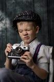 Baby boy with retro camera Royalty Free Stock Photography