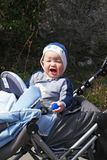 Baby boy rides in the stroller Stock Photography