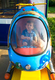 Baby boy riding in a helicopter Royalty Free Stock Photos