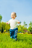 Baby boy running Royalty Free Stock Images
