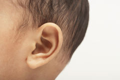 Baby Boy's Ear. Closeup of baby boy's ear on white background royalty free stock photography