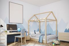 Baby boy s room with a computer, side view. Nursery with a mountain wallpaper, a wooden floor, a double bed with a house like roof and a computer desk. A framed Stock Photos