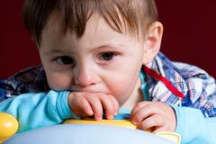 Baby boy with sad face Royalty Free Stock Image