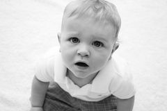 Baby Boy with a sad face. In black and white Stock Photos