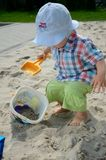 Baby boy in sandpit Royalty Free Stock Image