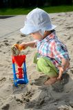 Baby boy in sandpit Royalty Free Stock Photos