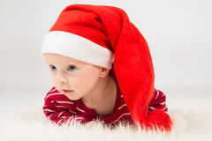 Baby boy in Santa Claus cap Royalty Free Stock Photos