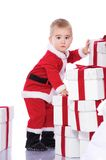 Baby boy in Santa Claus costume  Stock Photos