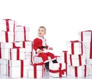 Baby boy in Santa Claus costume Stock Photo