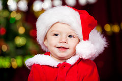 Baby boy in Santa hat Stock Photos