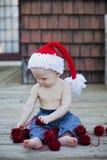 Baby boy in santa hat Stock Photos