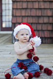 Baby boy in santa hat Stock Image