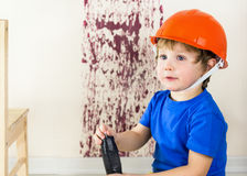 Baby boy with screwdriver in his hands Stock Photo