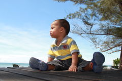 Baby boy at a seaside Stock Photos