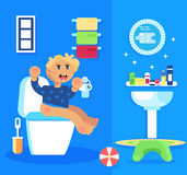Baby boy seating in the toilet. Stock Photos
