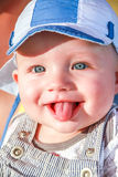 Baby boy is shooting tongue at people Stock Photos