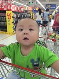 baby boy in shopping cart Stock Photography