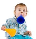 Baby boy shouting through a toy Royalty Free Stock Photography