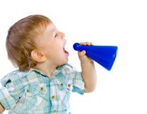 Baby boy shouting through a toy. Like megaphone, isolated Stock Photography