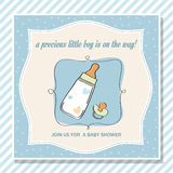 Baby boy shower card with milk bottle and pacifier Stock Photos