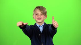 Baby boy shows thumbs up. Green screen. Slow motion stock video