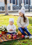 Baby boy with sister in autumn park Royalty Free Stock Images