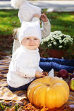 Baby boy with sister in autumn park Royalty Free Stock Photo