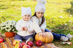 Baby boy with sister in autumn park Stock Photography