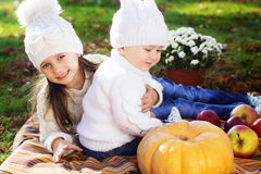 Baby boy with sister in autumn park Royalty Free Stock Photography