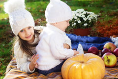 Baby boy with sister in autumn park Royalty Free Stock Image