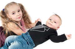 Baby boy with sister Royalty Free Stock Photos