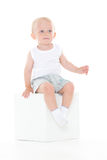 Baby boy sits on cube. Royalty Free Stock Photo