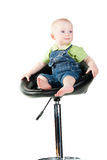 Baby boy sitting on a bar-chair Stock Photography