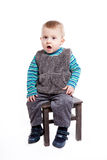Baby boy sitting on a chair Royalty Free Stock Photo