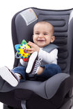 Baby boy sitting on child's car seat, isolated Royalty Free Stock Photo
