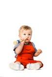 Baby boy with paint brush Stock Photo