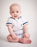 Baby Boy Sitting On Floor In Sailor Suit Stock Image